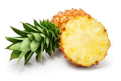 Fresh pineapple fruits with cut and green leaves royalty free stock images