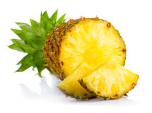 Fresh pineapple fruits with cut and green leaves isolated Stock Photos