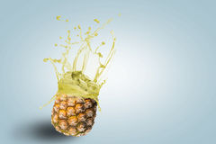 Fresh pineapple juice spills Royalty Free Stock Images