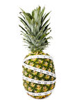 Fresh pineapple with a measuring tape Royalty Free Stock Image