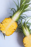 Fresh pineapple with slices on the background table. Pineapple on the background table Royalty Free Stock Image