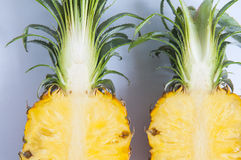 Fresh pineapple with slices on the background table. Pineapple on the background table Stock Photos