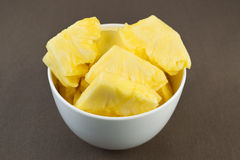 Fresh Pineapple Slices in Bowl Stock Image