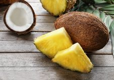 Fresh pineapple slices and coconut on  background Stock Photos