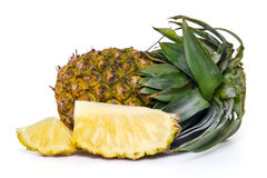 Fresh pineapple with slices isolated on white. Fresh pineapple (Also called as Ananas Comosus, Bromeliaceae pineapple, pine conifer, tupi nanas) isolated on Royalty Free Stock Photo