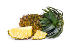 Fresh pineapple with slices isolated on white. Fresh pineapple (Also called as Ananas Comosus, Bromeliaceae pineapple, pine conifer, tupi nanas) isolated on Royalty Free Stock Photography