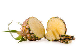 Fresh pineapple with slices isolated on white background Royalty Free Stock Image