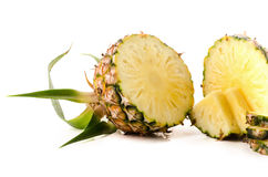 Fresh pineapple with slices isolated on white background Royalty Free Stock Photography
