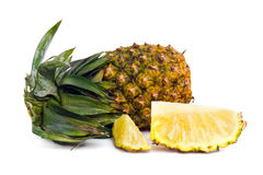 Fresh pineapple with slices  on white Royalty Free Stock Photos