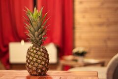 Fresh pineapple on table Stock Image