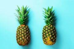 Fresh pineapples on blue background. Top View. Pop art design, creative concept. Copy Space. Bright pineapple pattern Stock Photography