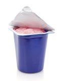 Fresh pink berry yogurt in blue plastic pot stock images