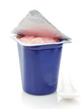 Fresh pink berry yogurt in blue plastic pot Royalty Free Stock Image
