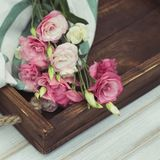 Fresh pink flowers frame on wooden background.  stock photo