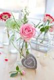Fresh flowers in little bottles Royalty Free Stock Image