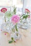 Fresh flowers in little bottles Stock Photography