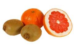 Fresh pink grapefruit, tangerine and kiwi Royalty Free Stock Photo