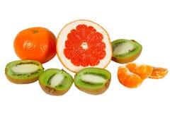 Fresh pink grapefruit, tangerine and kiwi Stock Photo