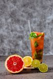 Fresh pink lemonade with lemon, lime and strawberries. Black background royalty free stock photo