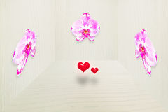 Fresh pink orchid on vintage gray wooden wall in 3D with two small red hearts Royalty Free Stock Photo