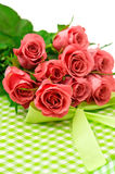 Fresh pink roses with gift over white background Stock Images