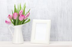 Fresh pink tulips bouquet and photo frame Royalty Free Stock Image