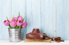 Fresh pink tulip flowers and camera Royalty Free Stock Photo