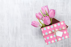Fresh pink tulip flowers in gift box Royalty Free Stock Photos