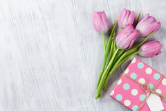 Fresh pink tulip flowers and gift box Royalty Free Stock Photos
