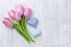 Fresh pink tulip flowers and hearts Royalty Free Stock Photos