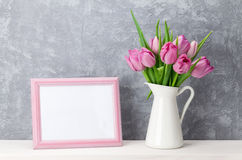 Fresh pink tulip flowers and photo frame Royalty Free Stock Image