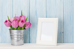 Fresh pink tulips bouquet and photo frame Royalty Free Stock Images