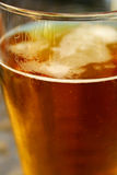 Fresh pint of beer. A macro photo of a pint of lager royalty free stock photography