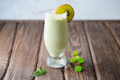 Fresh pistachio cocktail with kiwi. On a wooden background Stock Photography
