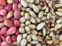 Fresh pistachios. Fresh peeled and unpeeled pistachios Royalty Free Stock Image
