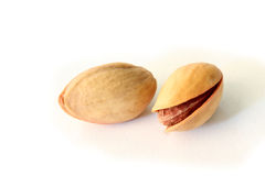 Fresh pistachios  on white Stock Images