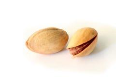 Fresh pistachios  on white Stock Images