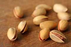 Fresh pistachios on wood backround,shallow dof Stock Image