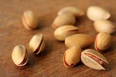 Fresh pistachios on wood backround,shallow dof Stock Image