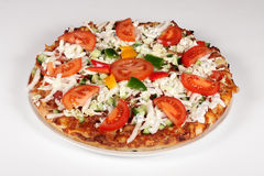Fresh pizza. On a plate on a white background Stock Photos