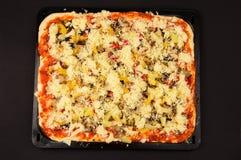 Fresh pizza before baking Royalty Free Stock Photo