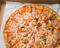 Fresh pizza in a box Royalty Free Stock Images