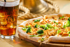 Fresh pizza made of broccoli, chicken and basil served with cold Royalty Free Stock Image