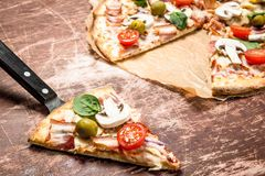 Fresh pizza with meat and tomatoes. royalty free stock image