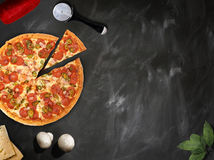 Fresh pizza with mushrooms salami pepper on dark beackground Stock Images