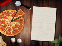 Fresh pizza with mushrooms salami pepper on dark beackground Royalty Free Stock Images
