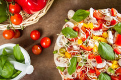 Fresh pizza and vegetables Stock Image