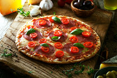 Fresh pizza on wood Stock Image