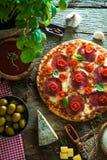 Fresh pizza on wood Royalty Free Stock Image