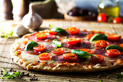 Fresh pizza on wood Royalty Free Stock Images
